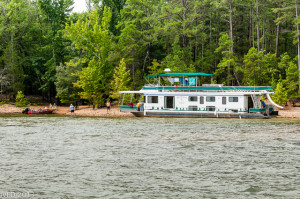 The DreamChaser Houseboat hard aground near point 5 on Lake Ouachita.