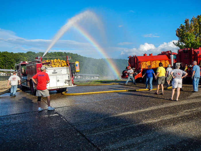Refilling tankers from Lake Ouachita.  Here, Engine 4 drafts from the lake and supplies two fill lines to Tanker 2.